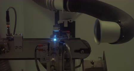lenda : Creating engraving on the coin by means of laser. Equipment at work