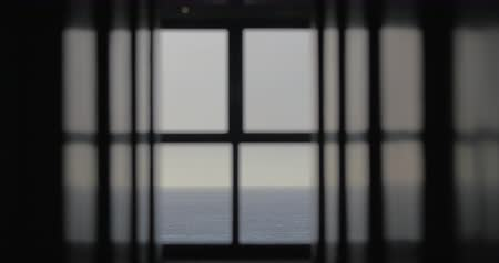 stále : Looking at sea or ocean from the house on the coast. Waterscape and skyline in the window Dostupné videozáznamy