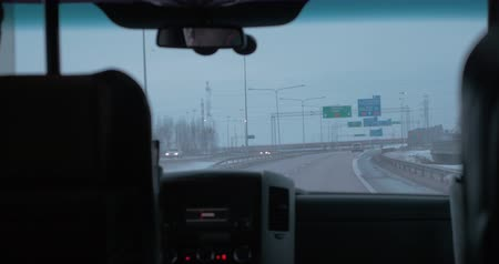 binnenstad : View to the highway with road pointers through the windscreen of moving car. Helsinki, Finland