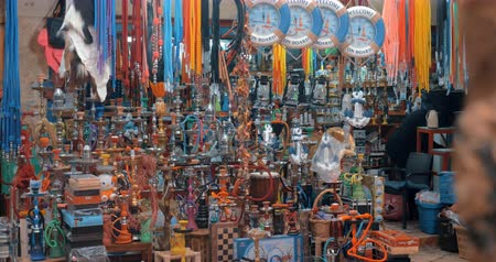 akko : ACRE, ISRAEL- MARCH 12, 2017: Vendor at old city market selling variety of hookahs and national souvenirs