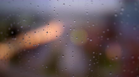 depressão : Close-up shot of rain drops on steamy window glass