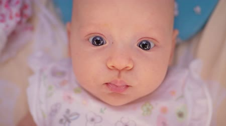 olhares : Slow motion close-up shot of lovely three months baby girl with big blue eyes