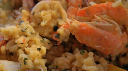 seafood dishes : Close-up shot of having meal with risotto. Sea food dish with shrimps and squid