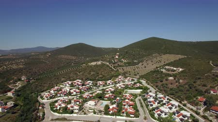 olivo arbol : Aerial view of town with cottages among green hills, transport traffic on the road. Scene of Trikorfo Beach, Greece