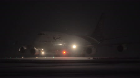 arrive : MOSCOW, RUSSIA - DECEMBER 18, 2017: Thai Boeing 747-400 with bright headlights driving on runway at night. Arrival at Domodedovo Airport. The flag carrier airline of Thailand formed in 1988