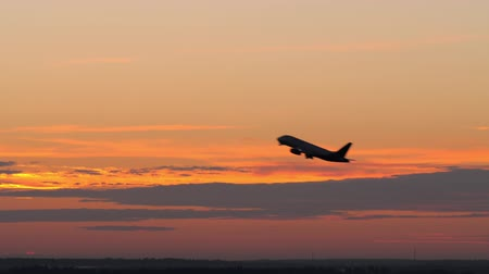 ascend : Slow motion shot of passenger airplane taking off and flying on the background of evening sky Stock Footage