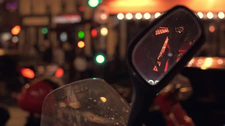 rouge : PARIS, FRANCE - SEPTEMBER 29, 2017: Night illuminated street with car traffic, motorbike mirror with Moulin Rouge reflection in foreground Stock Footage