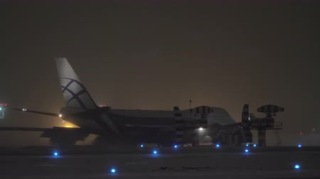 airbridgecargo : MOSCOW, RUSSIA - JANUARY 29, 2018: AirBridgeCargo Boeing 747 taxiing on runway at winter night. The largest Russian cargo airline. Sheremetyevo Airport