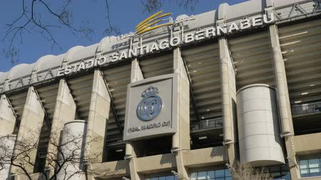 real madrid : MADRID, SPAIN - JANUARY 17, 2018: Outside view of Santiago Bernabeu Stadium with a logo of Real Madrid. Home stadium of a famous football team