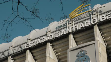real madrid : MADRID, SPAIN - JANUARY 17, 2018: Outside view of football stadium Santiago Bernabeu with Real Madrid logo. Home stadium of famous team Stock Footage