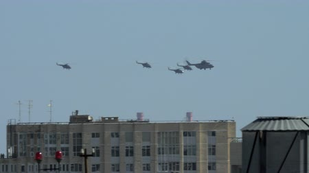 mi : MOSCOW, RUSSIA - MAY 09, 2018: Group of helicopters flying over the city during the parade on Victory Day. Mi-26 accompanied by four Mi-8