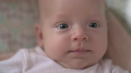 yeni : Close up shot of an adorable and happy and smiling newborn baby girl