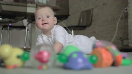 babygirl : Medium shot of an adorable baby girl playing on the carpet of her living room at home