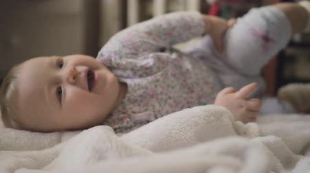 babygirl : Close up shot of an adorable 6 months baby girl playing on the carpet at home