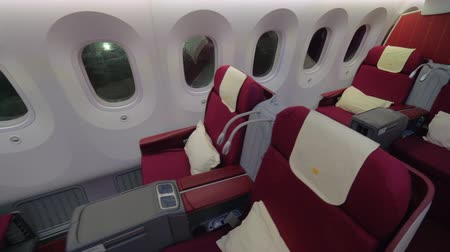first class : Wide shot of a jet airplane interior view without people seated inside the cabin, business class