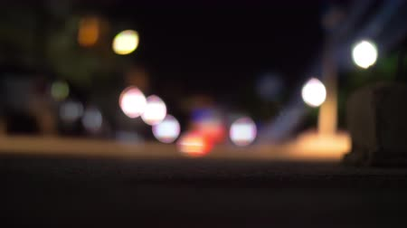 světlomety : Slow motion shot of dark road is in the light of headlamps and defocus of car driving with red backlights