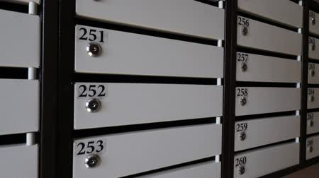 levelezés : Close-up shot of a row of locked mailboxes in the apartment house