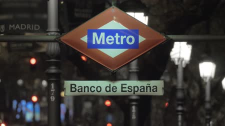 espana : Street sign of Banco de Espana subway station, view in night city. Madrid, Spain