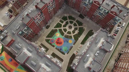 hipoteca : Aerial shot of residential compound and inner court with following view to housing complex with buildings under construction. New Moscow, Russia