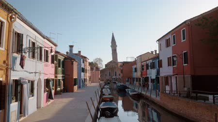 burano : Quiet scene of Burano island with coloured houses, canal with boats and Leaning Bell Tower