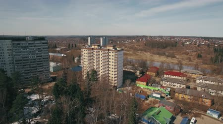 пригородный : Flying over suburban district with several apartment blocks surrounded with trees, spring view, Russia
