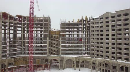 kusy : Aerial shot of multistorey apartment complex under construction. Winter view, Russia Dostupné videozáznamy