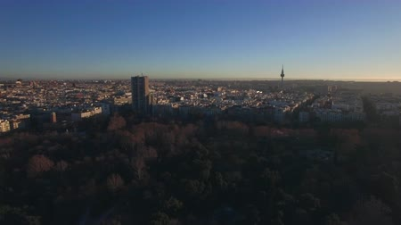 city park : Aerial scene of Madrid, Spain in winter morning. City view with Buen Retiro Park, city buildings and Torrespana