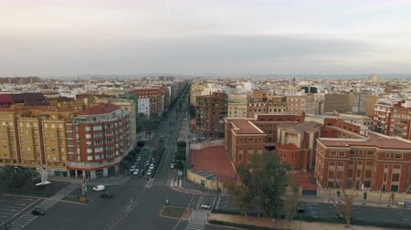 built : Aerial shot of Valencia, Spain. City buildings on Peris i Valero and Jacinto Benavente streets with car traffic. Winter view