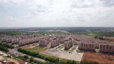 Aerial spring view of new built apartment blocks and green woods in New Moscow area, Russia