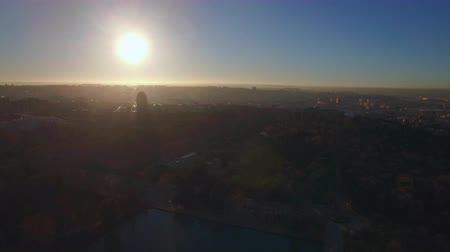 Aerial city scene of Madrid, Spain. View to the buildings and Buen Retiro Park with lake in bright light of morning winter sun 影像素材