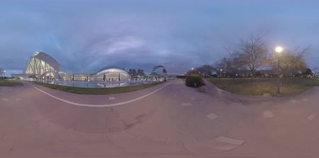 príncipe : 360 VR video. Valencia in the dusk, Spain. View to the illuminated complex City of Arts and Sciences with near-by park and people walking there Stock Footage