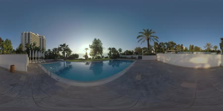 antalya : 360 VR video. Resort on the coast of Antalya, Turkey. Scene with hotel building, outdoor swimming pool and sea