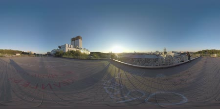 observation deck : MOSCOW, RUSSIA - SEPTEMBER 22, 2017: 360 VR video. Young couple and a man (with model release) enjoying city panorama at sunset. Observing capital from RAN viewing point