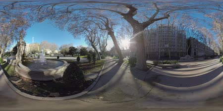 forrado : 360 VR Paseo del Prado with Apollo Fountain in Madrid, Spain. View to the city buildings, car traffic and tree-lined pedestrian walkway