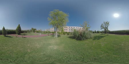 360 VR Video. Hotel building and garden with paths, green lawns and hedges. Resort in Nea Kallikratia, Greece