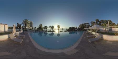 antalya : 360 VR video. Resort on the coast of Mediterranean Sea. Hotel and its area with pools and garden. Peaceful vacation scene with seascape and sunshine. Antalya, Turkey