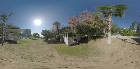 cisza : 360 VR video. Bright sun shining over the coastal resort in Turkey, Antalya. Hotel area with garden, gazebos and swimming pool