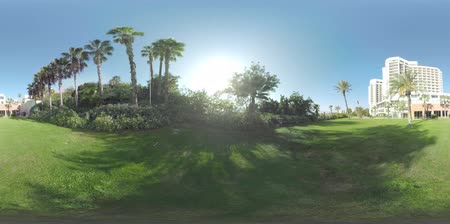 antalya : 360 VR video. Greenspace with palms around the hotel building on the coast of Mediterranean Sea. Holidays in Antalya, Turkey