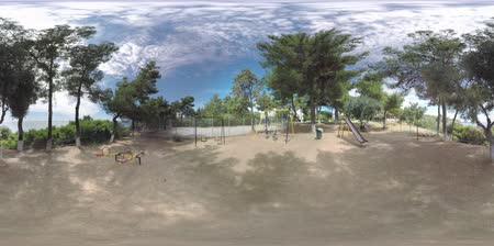 360 VR Video. Father watching boys having fun on the swings. Children playground on the territory of Trikorfo Beach resort with villas for rent 影像素材