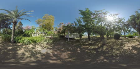 360 VR video. Beautiful green garden overlooking the sea on the resort in Turkey, Antalya. Gazebo in the shade of trees 影像素材