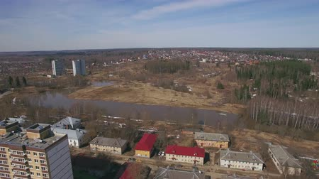 předměstí : Aerial view of township with several multistorey apartment blocks, view in spring. Living in city outskirts, Russia
