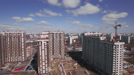 inacabado : Aerial spring shot of new-built and unfinished highrise apartment blocks and city view. Moscow, Russia Stock Footage