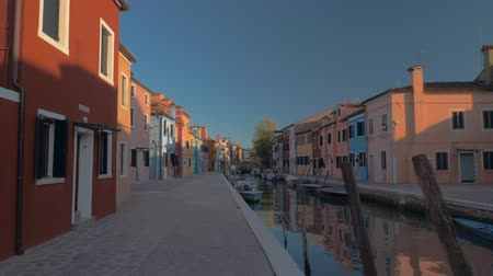 水路 : Quiet scene of Burano island. Street with painted houses along the canal with moored boats. Popular touristic destination in Italy 動画素材