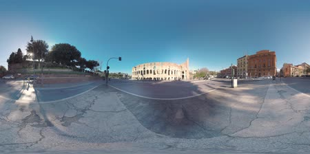 zebry : 360 VR video. Rome view in winter morning, Italy. Cityscape with the main landmark Colosseum, houses, car traffic and people walking in Celio Vibenna street