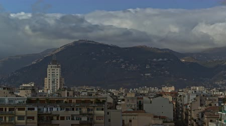 lesiklás : Timelapse shot of clouds sailing over the city, scene with green hills in Palermo, Italy