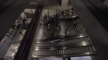 kijárat : Speed-up shot of people getting up in underground by stairs and escalators,high-angle shot Stock mozgókép