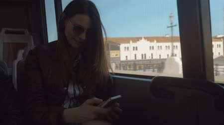 surfing the net : Young woman surfing the net on smart phone when traveling bus in the city