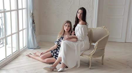 eleganckie : Two romantic fashion models posing sitting on chair in beaytiful interior