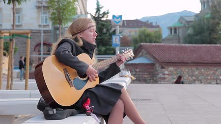 acoustical : SOFIA, BULGARIA - SEPTEMBER 2016: Street musician women with guitar songs