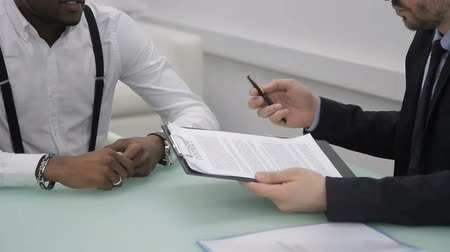 закон : Business partners are signed contract in international company indoors. Two successful men shake hands by signing agreement in modern office.